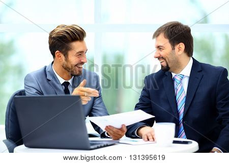 Business men discussing together in an office