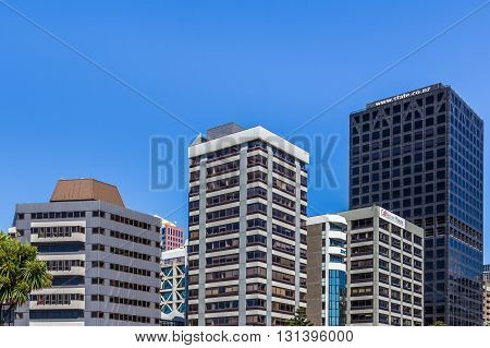 Wellington, New Zealand, February 13 2016 - Cityscape of new high-rise buildings in Wellington New Zealand against a blue sky
