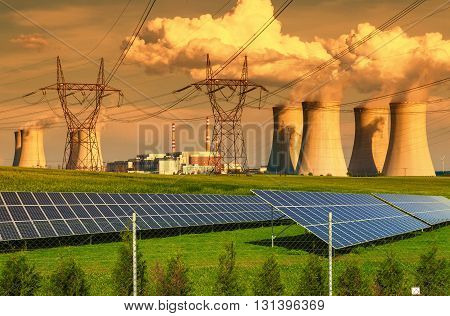Nuclear power plant Dukovany with solar panels at sunset in Czech Republic