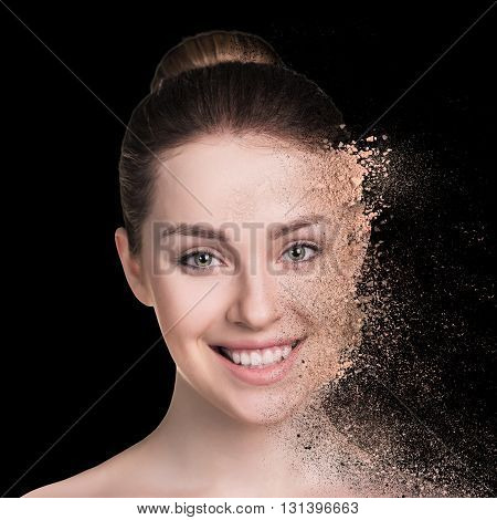 Woman and crumbly powder on the black background