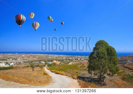Balloons flying over the valley of Crete towards the sea.