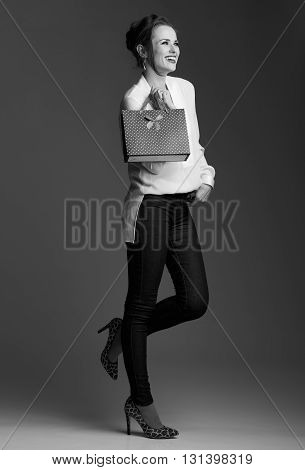 Happy Modern Elegant Woman With Shopping Bag Looking Aside