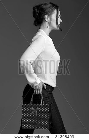 Modern Woman With Shopping Bag Posing Against Grey Background