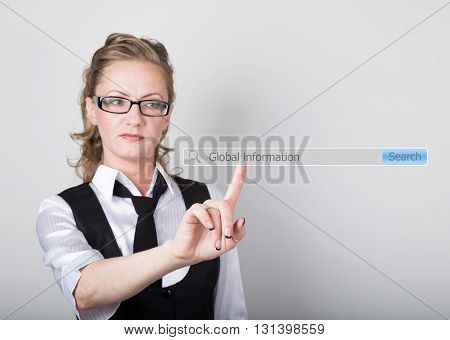 Global information written in search bar on virtual screen. technology, internet and networking concept. Internet technologies in business and home. woman in business suit and tie, presses a finger on a virtual screen.
