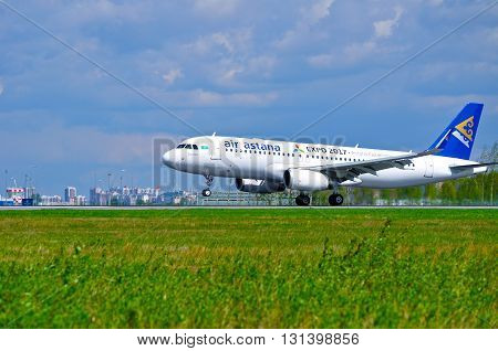 SAINT PETERSBURG RUSSIA - MAY 11 2016. Air Astana Airbus A320 aircraft -registration number P4-KBC- is riding on the runway after arrival at Pulkovo International airport