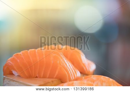 Salmon sushi Japanese food delicious menu bokeh defoused background with copy space