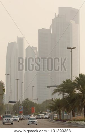 ABU DHABI, UAE, 30 MARCH 2016.  Editorial Photograph of Corniche Skyscrapers in Abu Dhabi during a severe sand storm.  The city is shrouded in sand and dust from the desert, whipped up by high winds.