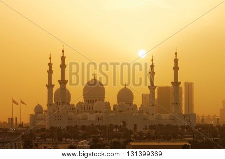 ABU DHABI, UAE, 28 MARCH 2016.  Editorial Photograph of Sheikh Zayed Grand Mosque in Abu Dhabi during a severe sand storm.  The city is shrouded in sand and dust from the desert, whipped up by high winds.