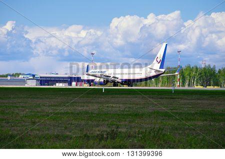 SAINT PETERSBURG RUSSIA - MAY 11 2016. Orenair Airlines Boeing 737-800 airplane-registration number VQ-BSS- is landing in Pulkovo International airport
