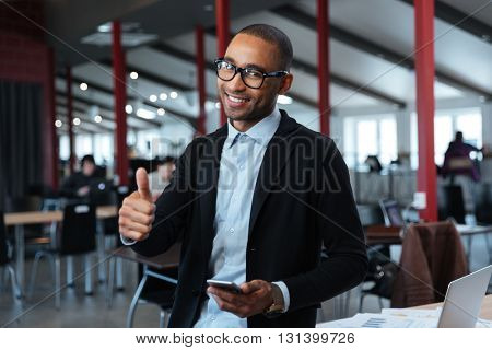 Smilling young businessman show okay sign in the office