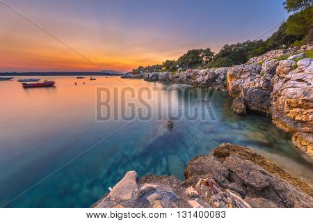 Colorful Sunset Over The Rocky Coast Of Croatia