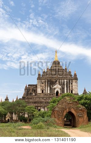 an ancient Buddhist temple complex in Bagan Myanmar pagodas with stupas on the background of the beautiful nature of trees and sky