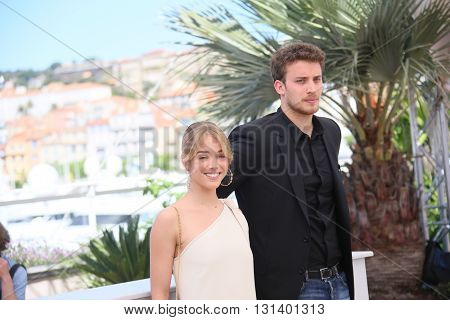 CANNES, FRANCE - MAY 21: Jonas Bloquet,  Alice Isaaz attend the 'Elle' Photocall during the 69th annual Cannes Film Festival at the Palais des Festivals on May 21, 2016 in Cannes, France.