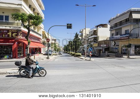 HERAKLION, GREECE - MAY 16: Moped driver on a street in Heraklion, Crete at May 16, 2106