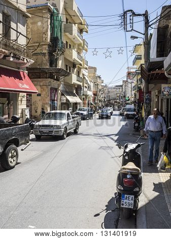 HERAKLION, GREECE - MAY 16: Street view with people and cars in Heraklion at May 16, 2016