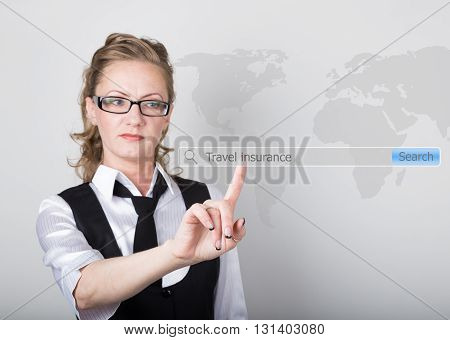 Travel insurance written in search bar on virtual screen. technology, internet and networking concept. Internet technologies in business and home. woman in business suit and tie, presses a finger on a virtual screen.