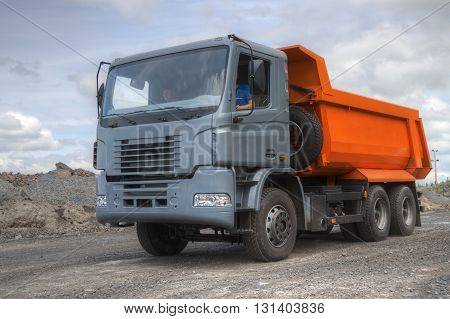 Poltava Region Ukraine - June 26 2010: Dump truck with gray cabin on the iron ore opencast
