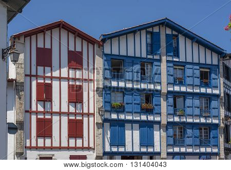 Typical buildings of Basque country in a street of Ciboure. Aquitaine France.