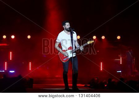 KISSIMMEE, FL-MAR 18: Singer Matt Ramsey of Old Dominion performs onstage at the Runaway Country Music Fest at Osceola Heritage Park on March 18, 2016 in Kissimmee, Florida.