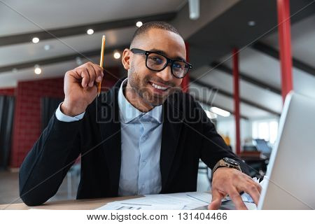Clever businessman having a good idea holding a pencil