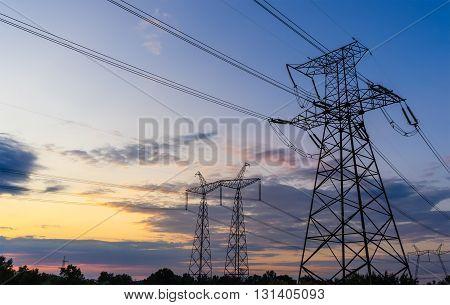 Power Line. pylon against a blue sky.