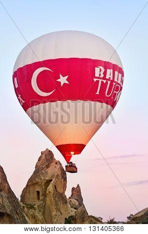 Goreme Turkey - April 27 2016: Hot air balloons over mountain landscape in Cappadocia Goreme National Park Turkey.
