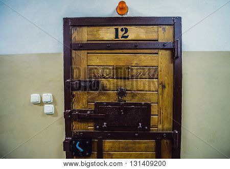 Old wood and metal cell door in polish prison