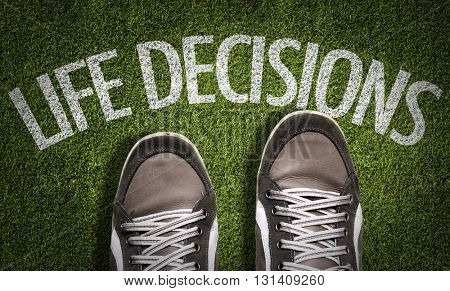 Top View of Sneakers on the grass with the text: Life Decisions