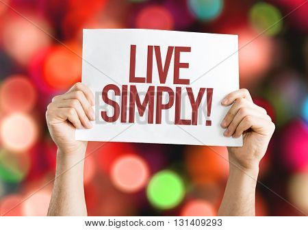 Live Simply placard with bokeh background