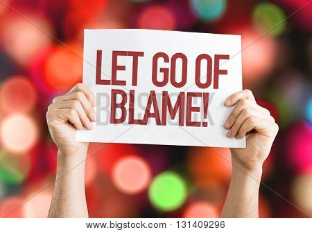 Let Go Of Blame placard with bokeh background