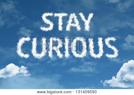 Stay Curious cloud word with a blue sky