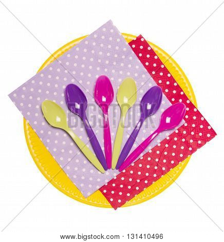 Disposable plate, colorful spoons and napkins isolated on white background.