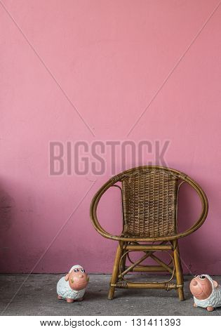 Rattan chair and pink wall for relaxing time