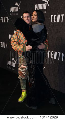 NEW YORK-FEB 12: Fashion designer Jeremy Scott (L) and Rihanna attend the FENTY PUMA by Rihanna AW16 Collection during Fall 2016 New York Fashion Week on February 12, 2016 in New York City.