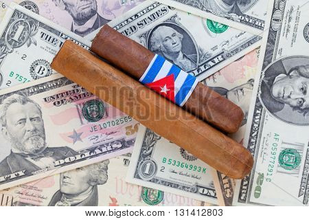Detail of luxury Cuban cigars on the US dollar banknotes