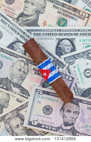 Detail of luxury Cuban cigar on the US dollar banknotes