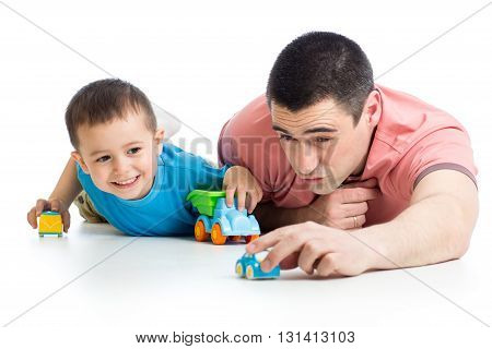 Daddy and little child boy playing with toy cars