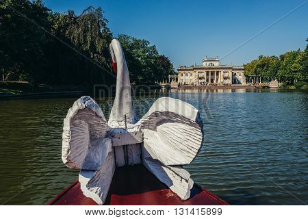 small tourist boat in Lazienki Royal Baths Park in Warsaw Poland