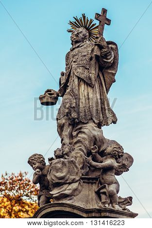 figure of saint in front of Church of Saint John the Babtist in Mikulov town in Czech Republic