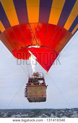 Goreme Turkey - April 29 2016: Hot air balloons over mountain landscape in Cappadocia Goreme National Park Turkey.