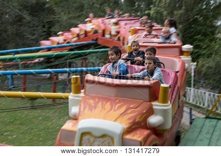 Bishkek, Kyrgyzstan - September 30, 2014: Kyrgyz children having fun in an amusement park.