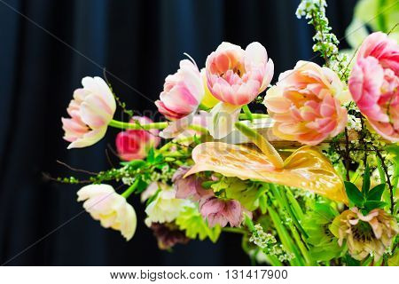 Flower wedding holiday decoration, beautiful pink roses peony blooming bouquet on black background