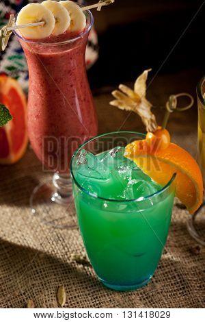 Blue Alcohol Cocktail with Orange Slice
