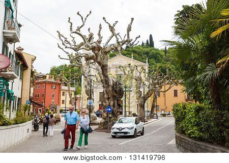 Garda Italy - May 03 2016: The tourists walking on the square of Rome in the little resort town