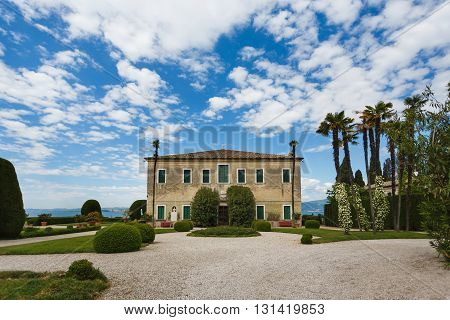 Saint Vigilio Italy - May 03 2016: View of the famous villa on the shore of Lake Garda spring time