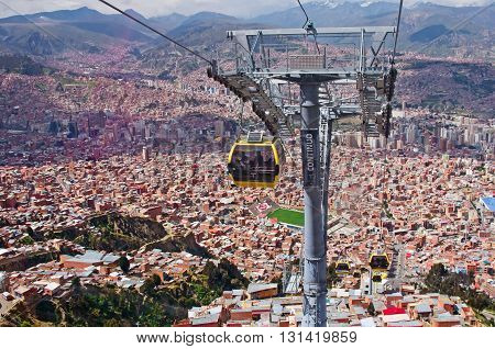 LA PAZ BOLIVIA - APR 03 2015: Cable cars carry passengers in La Paz. Aerial cable car of urban transit system opened in 2014 in the Bolivian city of La Paz.