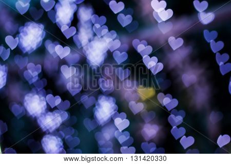 Blurring lights bokeh background of blue hearts