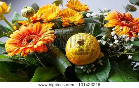 bouquet of orange flowers perfect for Mothers day or birthdays. Peonies Bridal Veils green leaves and daisies