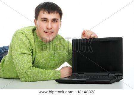 Handsome young man with a laptop.