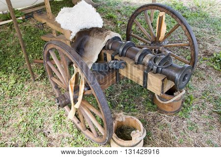 TEWKESBURY, UK - 17 July 2015 : Wood & wrought iron replica muzzle loading cannon on 17 July at Tewkesbury Medieval Festival, UK